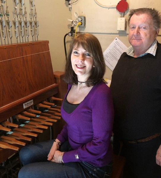 The current chimers of St. Mark's, Christine Bishop and Paul Wiebe, squeeze into the tiny keyboard room, two floors above ground and one floor below the belfry. (Tim Taylor/Niagara Now)