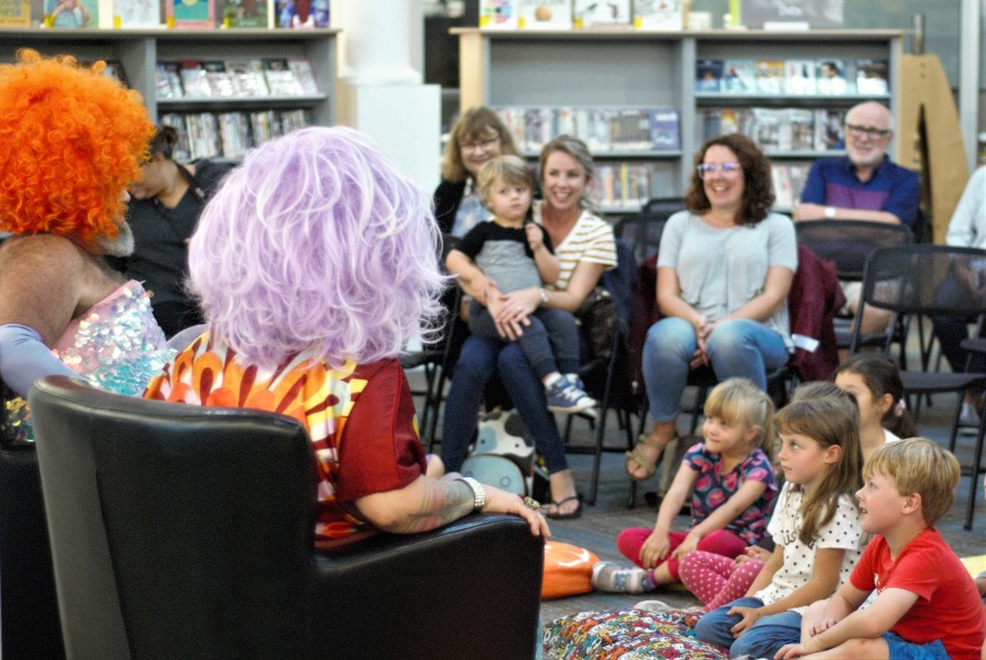 Children listen intently to Fay and Fluffy as they read books about inclusion, acceptance and being true to yourself on Saturday afternoon. (Brittany Carter/Niagara Now)