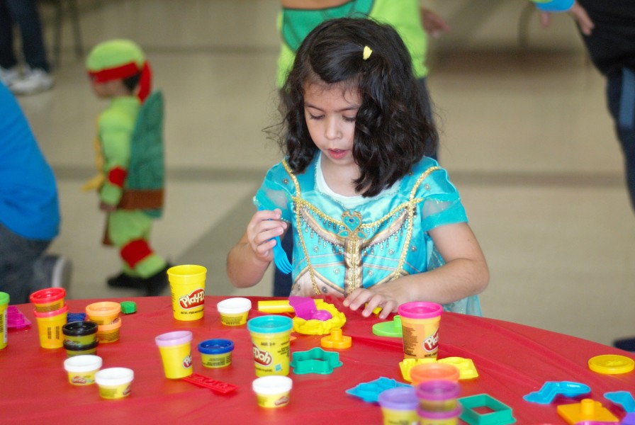 Hope Papadopoulos plays with Play-Doh during Saturday's Harvest Party at the community centre. (Brittany Carter/Niagara Now)