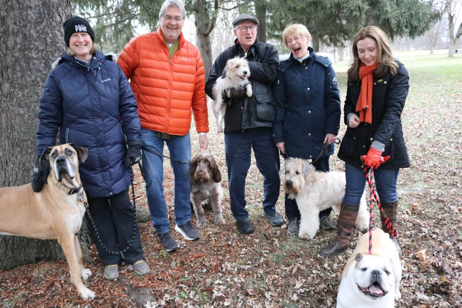 From left: Maureen Dodd with her dog Miles, Frank Wynia and his dog Coco, John McCallum holds his dog Sykes, Carol Williams with Connor and Nikki Jenkins with a bulldog called Winston. (Dariya Baiguzhiyeva/Niagara Now)