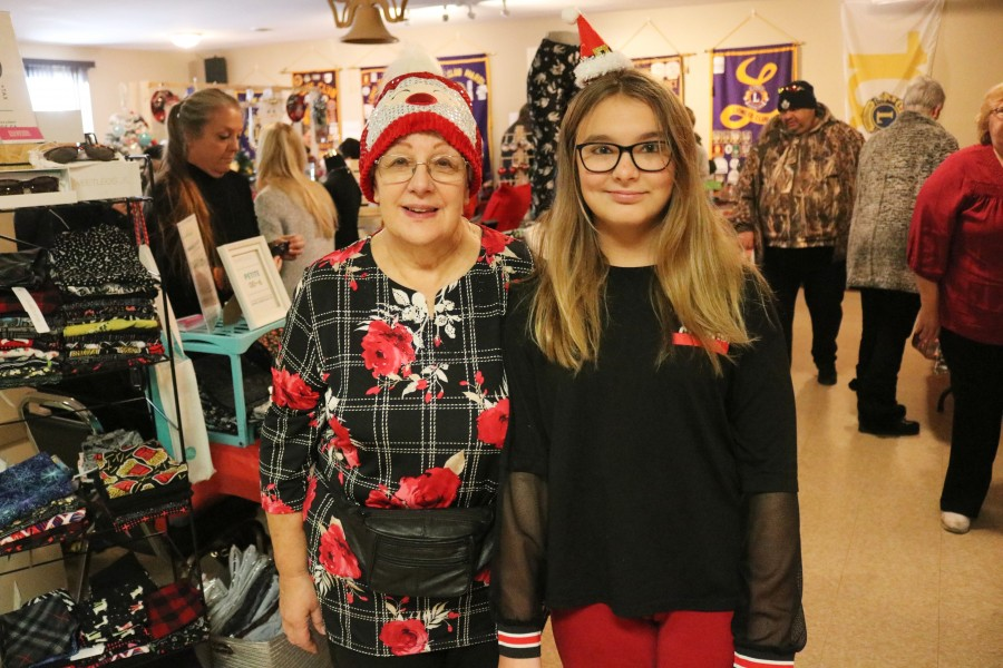 Event co-ordinator Diane Pewer with her granddaughter Alyssa Dauginas who helped to set up the event. (Dariya Baiguzhiyeva/Niagara Now)
