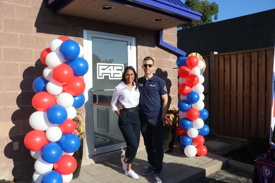 Owners Jack Addams Williams and Neesha Jayalathge stand in front of their new fitness studio in Virgil. (Dariya Baiguzhiyeva/Niagara Now)