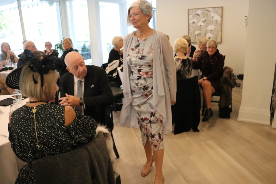 Jeannie Manning shows one of the outfits from the Canadian designer Joseph Ribkoff's 2020 spring collection.(Dariya Baiguzhiyeva/Niagara Now)