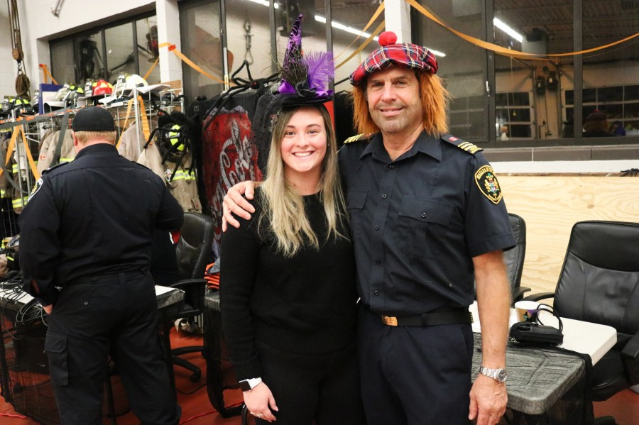 Lindsay Crews and Dave Jones, assistant district chief, at the Queenston fire hall. (Dariya Baiguzhiyeva/Niagara Now)