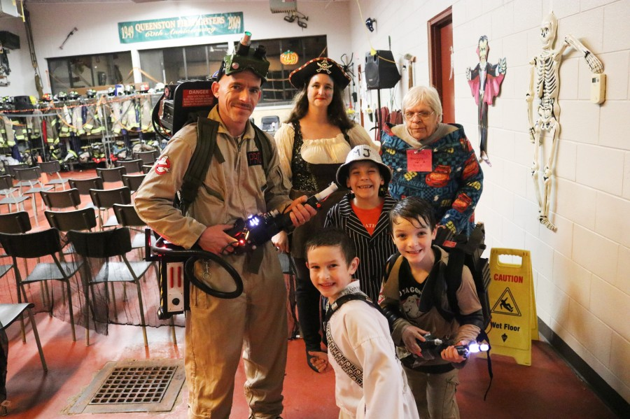Mike and Meghan Prosyk dressed as ghostbuster and a pirate. Far right is Cheryl Prosyk and children Michael (dressed as Michael Jackson), Mark (as ghostbuster) and Matthew (as ninja.) (Dariya Baiguzhiyeva/Niagara Now)