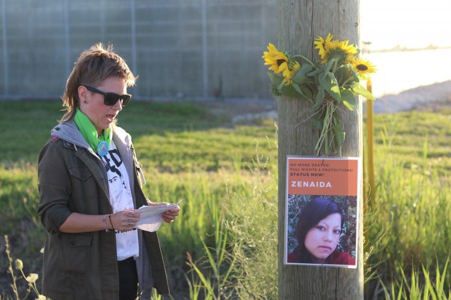 Kit Andres, of the Migrant Workers Alliance for Change, stands in front of a memorial for a migrant worker Zenaida who died after a hit-and-run.  (Dariya Baiguzhiyeva/Niagara Now)