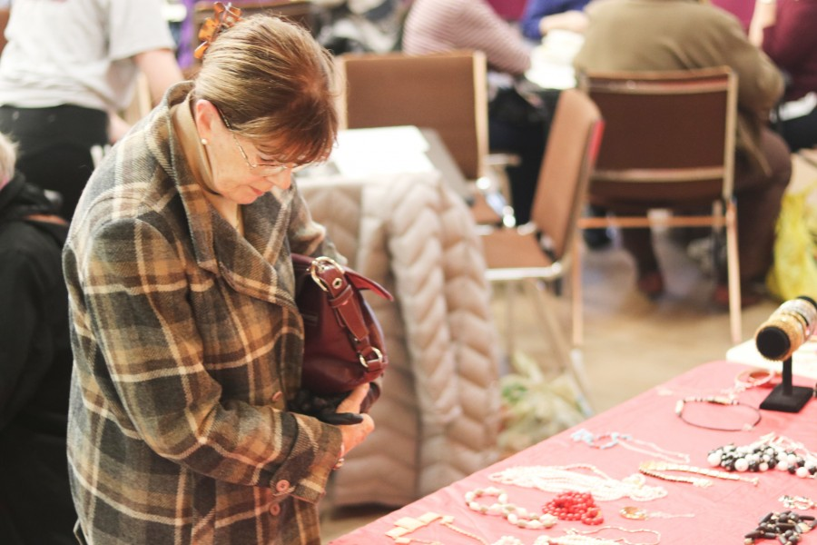 Maggie Davis browses sale items at the annual St. Davids-Queenston United Church bazaar Saturday.(Dariya Baiguzhiyeva/Niagara Now)