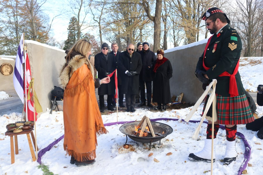 Assistant director at Landscape of Nations, Michele-Élise Burnet,t and Sgt. Raymond Starks perform a tobacco ceremony. (Dariya Baiguzhiyeva/Niagara Now)
