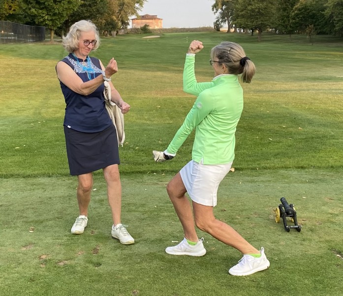 Team Blue captain Margot Richardson. left, and Team Green captain Maria Townley mix it up prior to their teams' match play .jpg competition. (May Chang photo)