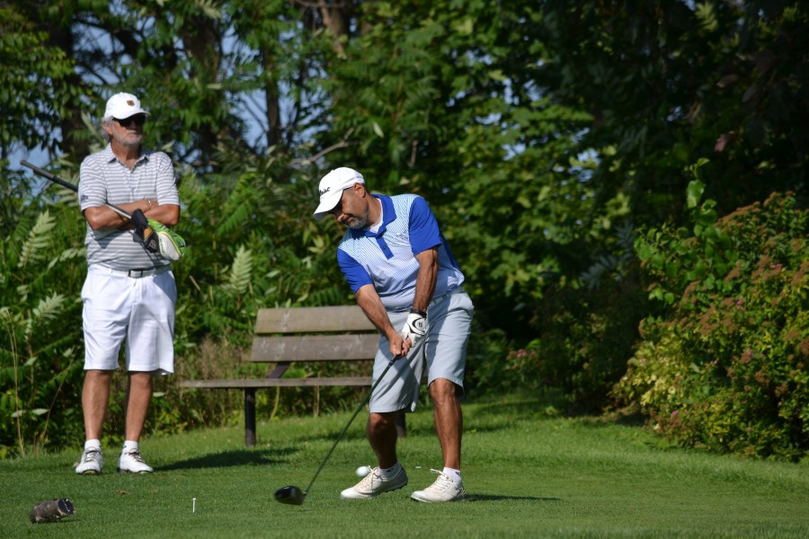 With former champ Stephen Warboys watching, Joe Doria tees off on the 17th hole. The two were tied at this point, but a double-bogey by Warboys put Doria ahead to stay.  (Kevin MacLean/Niagara Now)