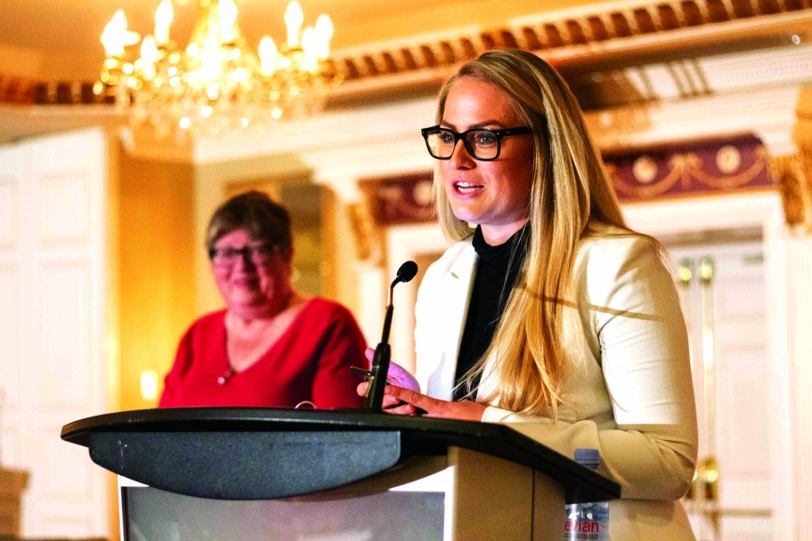 Raiana Schwenker speaks to her father's achievements and contributions for winning the Citizen of the Year Award at the Spirt of Niagara Awards. (Jer Houghton/Niagara Now)