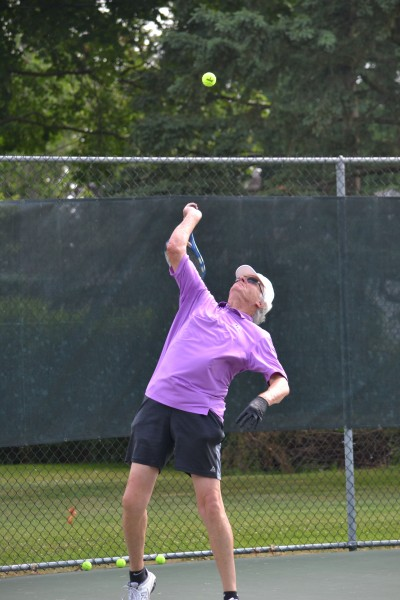 Larry Mantle delivers a serve.  (Kevin MacLean/Niagara Now)