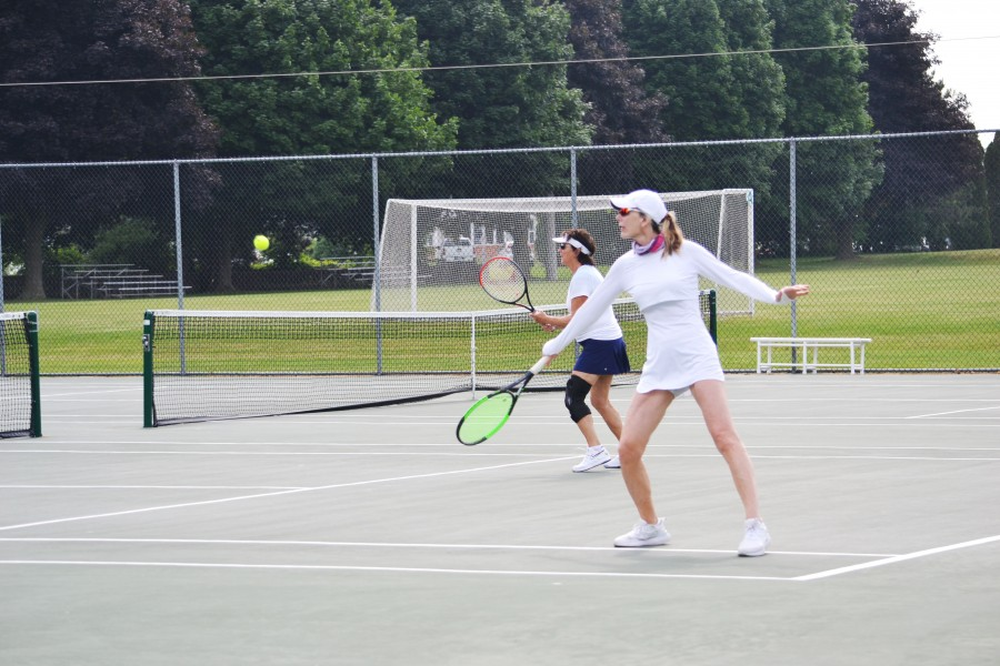 Nancy Berkhout returns a shot, with partner Pat Odey.  (Kevin MacLean/Niagara Now)