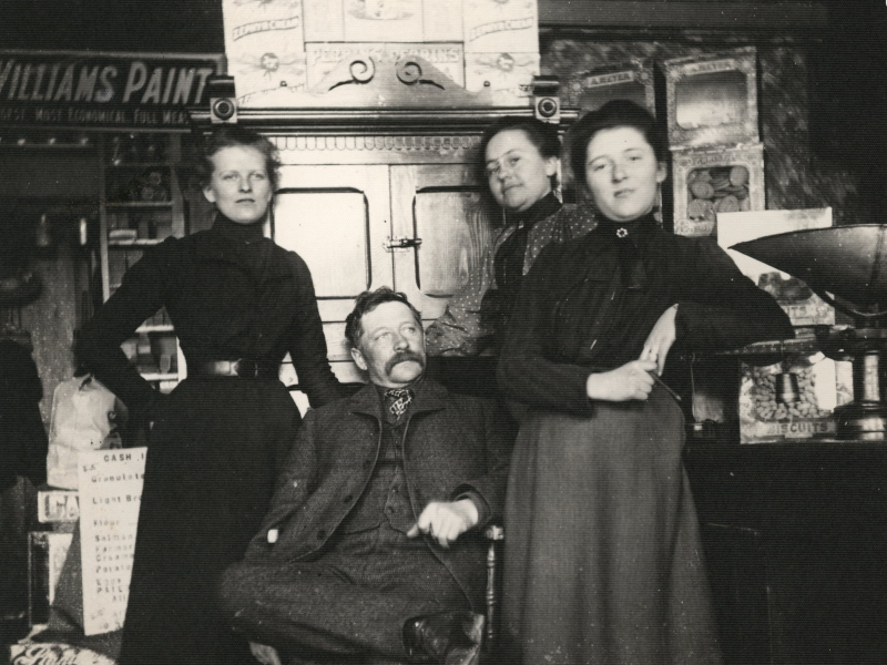 harles Matthew Lowrey with his three daughters, Luella, Edna and Marguerite. The picture taken inside the general store he owned and operated in Queenston. Undated, probably in the 1910s. (Supplied)